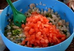 Ceviche preparation - adding condiments