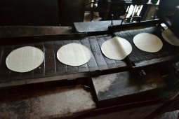 Production belt after pressing and cutting the dough in shape